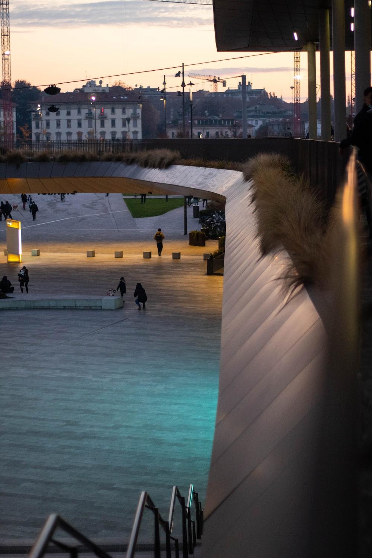 people walking on swimming pool during night time