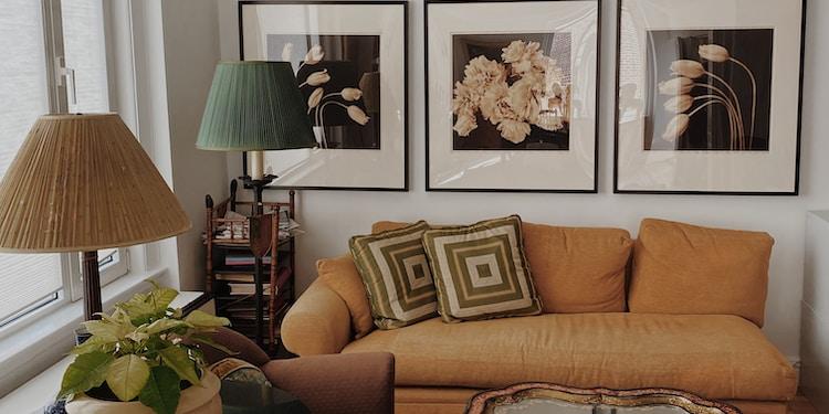 brown sofa near black metal framed glass top coffee table