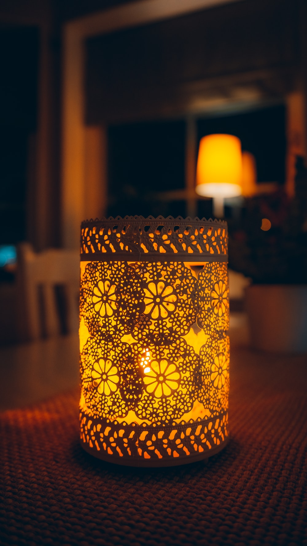 yellow and black floral candle holder