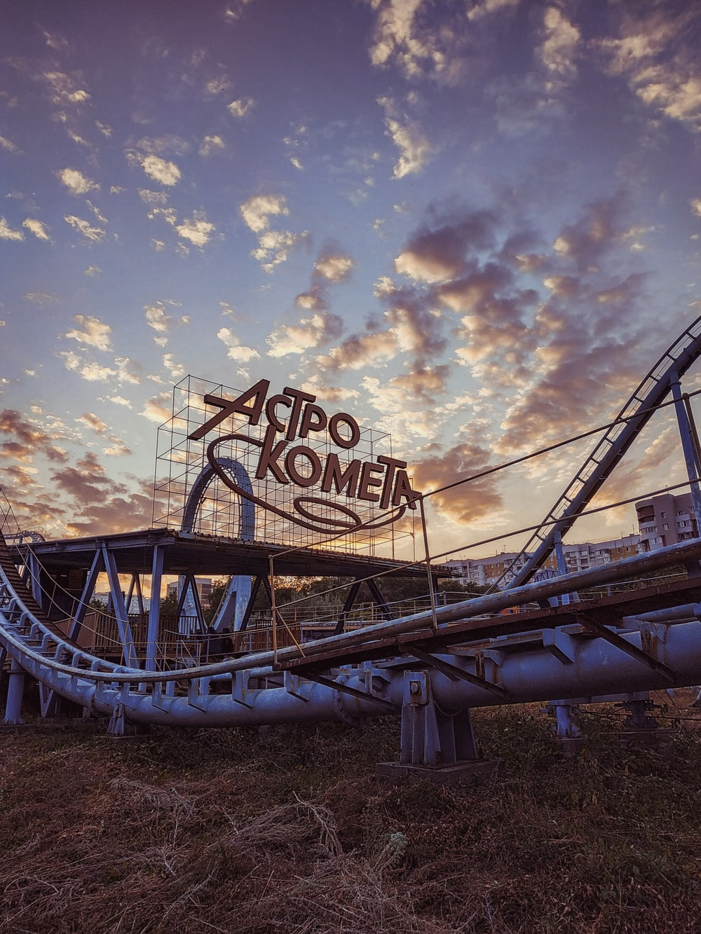 blue and white roller coaster under blue sky during daytime