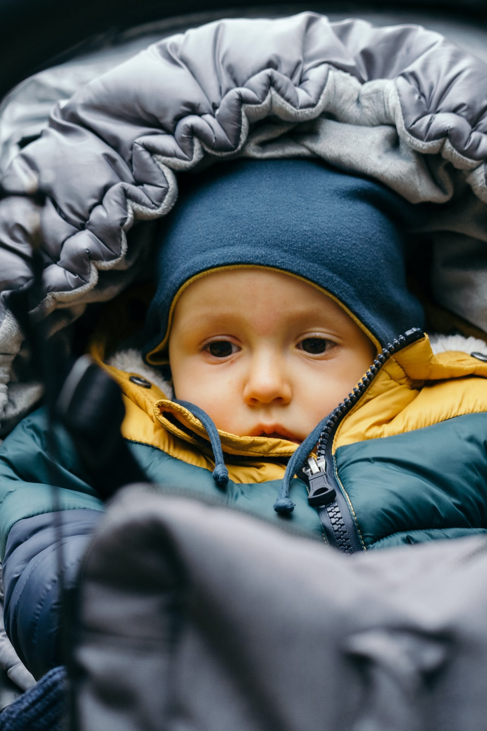 baby in blue and yellow jacket