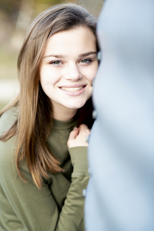smiling woman in green long sleeve shirt