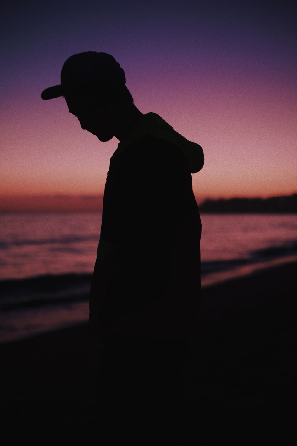 silhouette of man wearing hat during sunset
