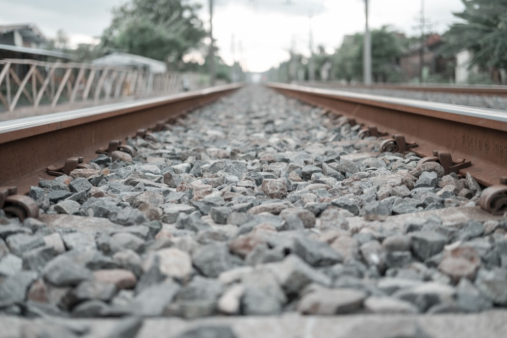 gray and brown train rail