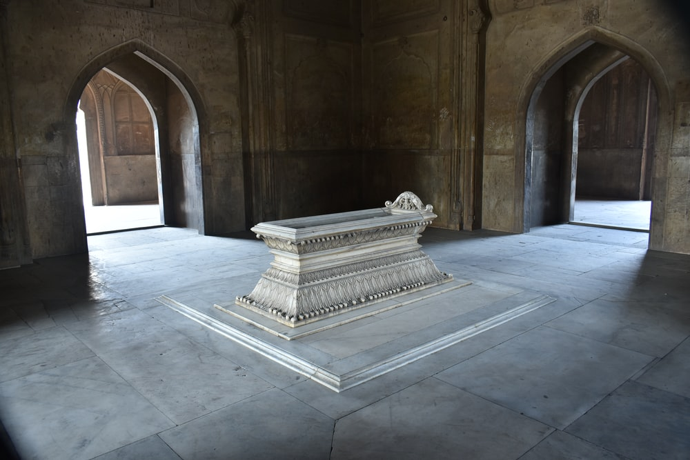 white concrete bench inside building