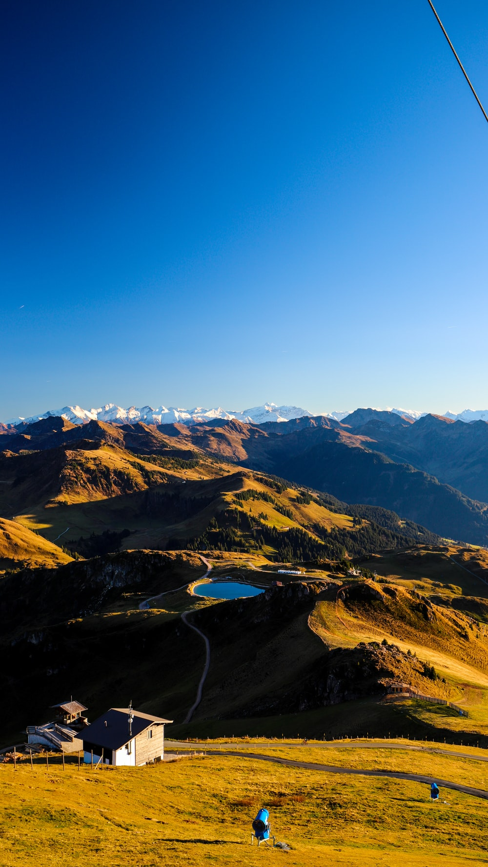 aerial view of lake in the middle of mountains during daytime