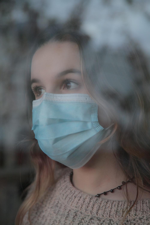 woman wearing white face mask