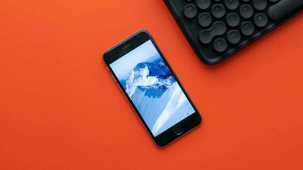 black iphone 5 on red table