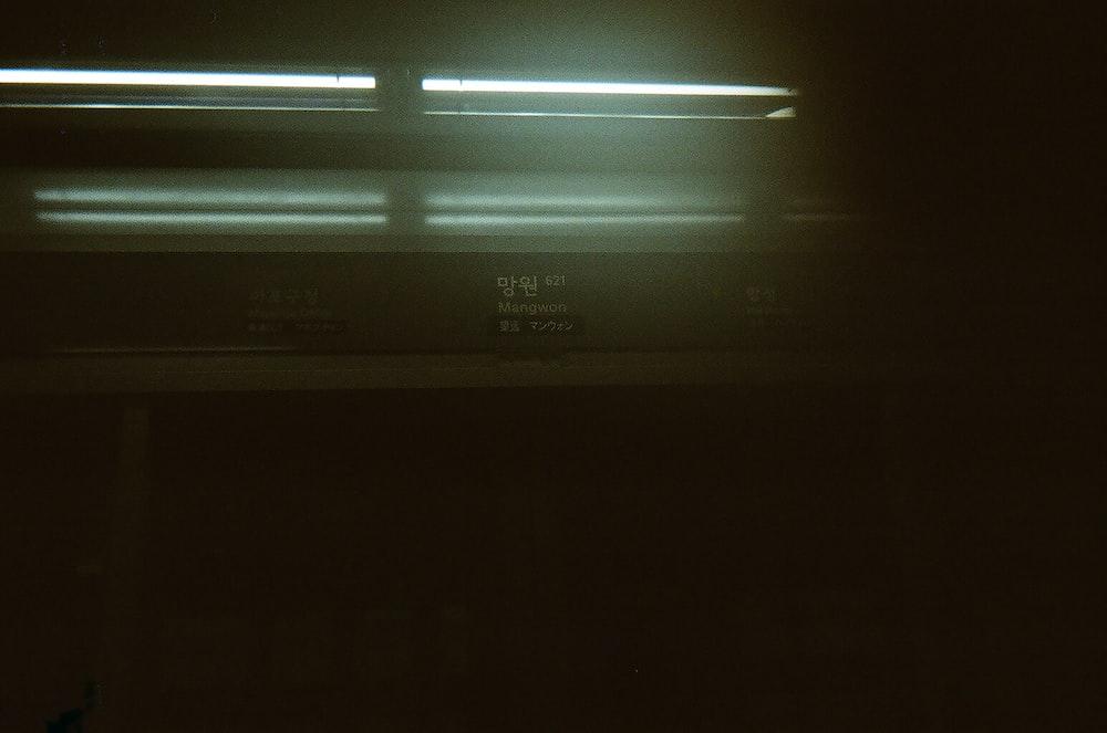 black flat screen tv turned on showing blue screen