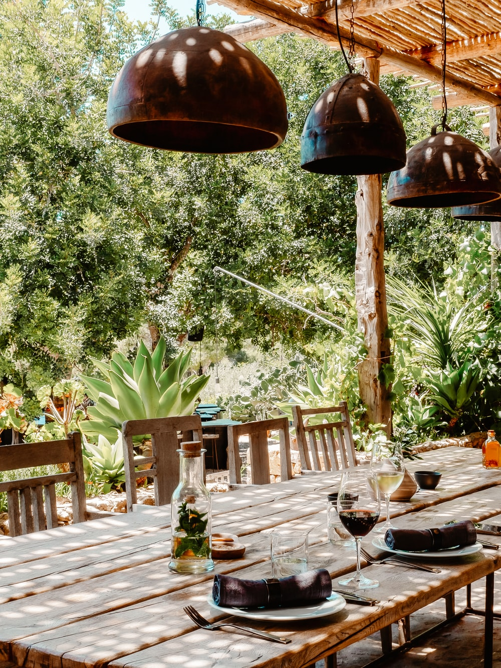 brown wooden table with chairs and green plant