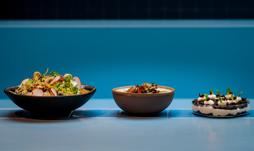 brown and blue ceramic bowl with food