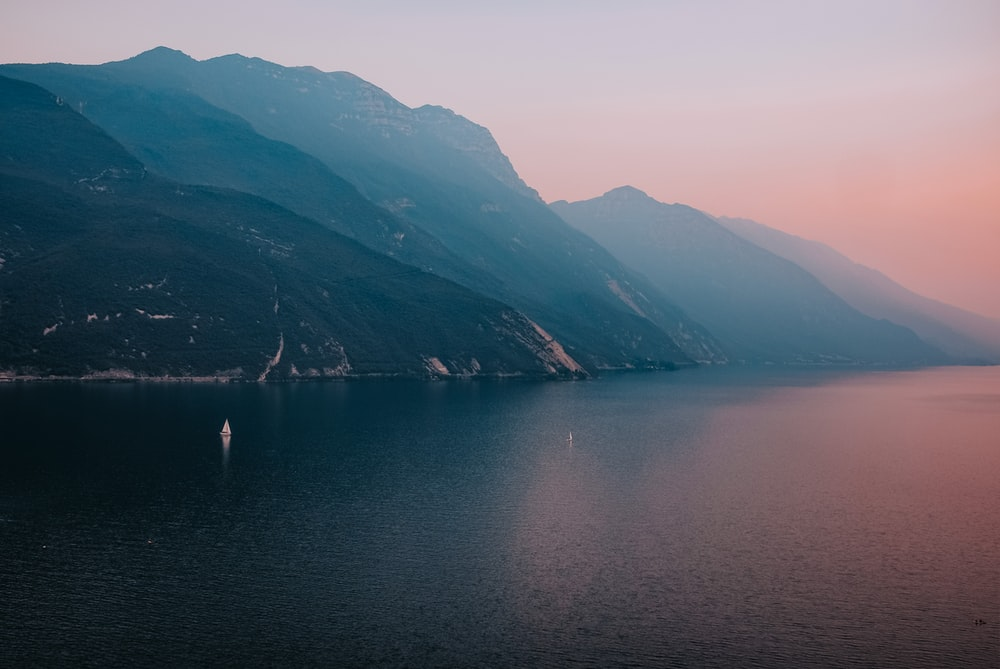 body of water between mountains during daytime