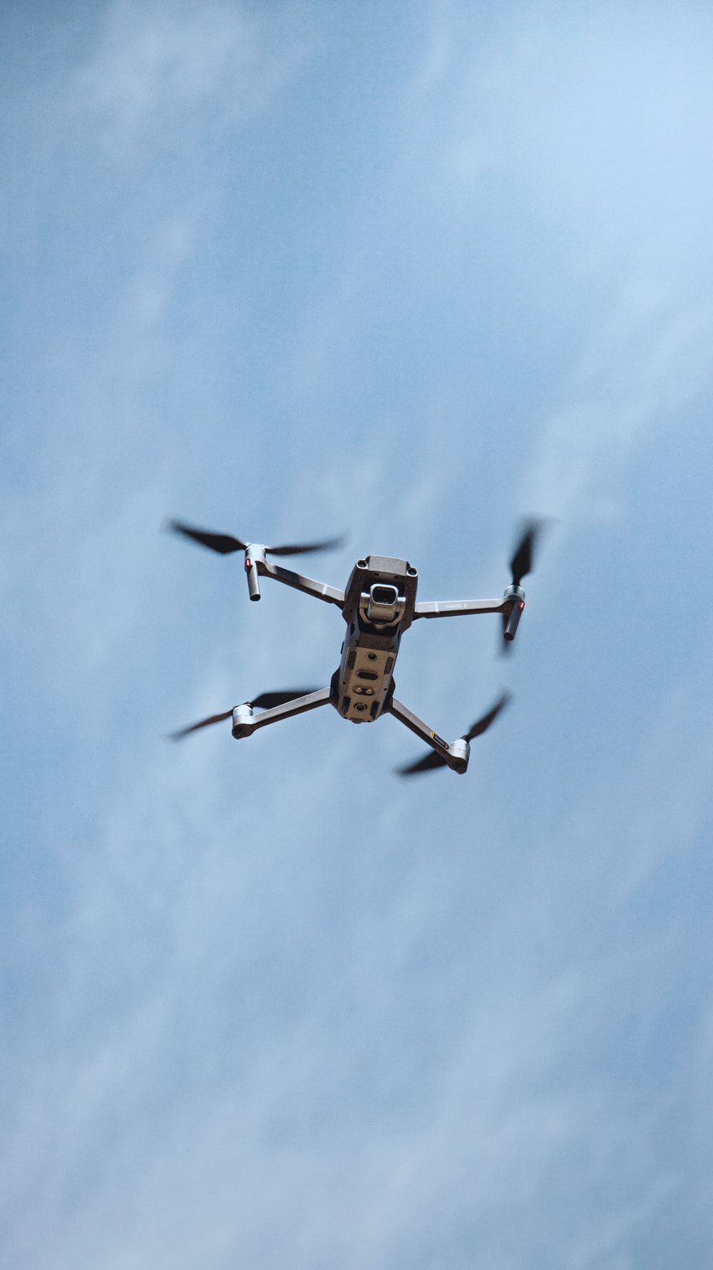 black and yellow drone flying in the sky