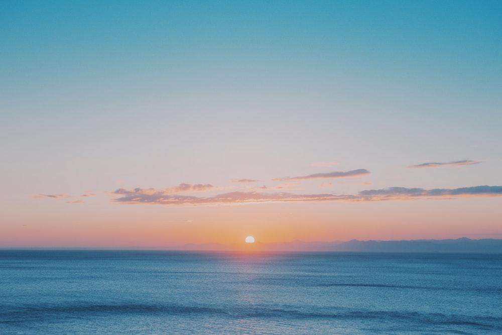 blue sea under blue sky during sunset