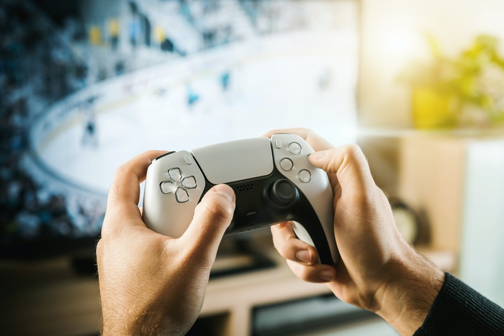 person holding black game controller