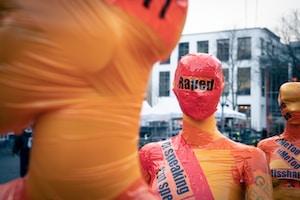 man in orange crew neck shirt