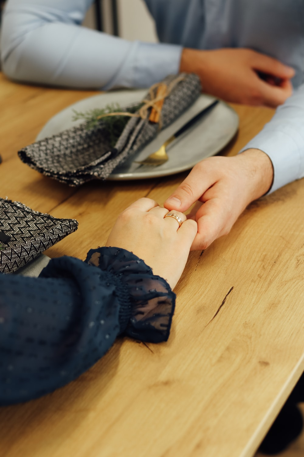 person in blue gloves holding silver fork
