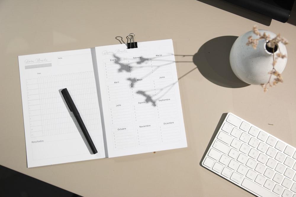 black pen on white printer paper