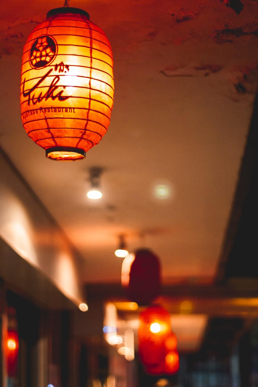 yellow paper lantern on white ceiling