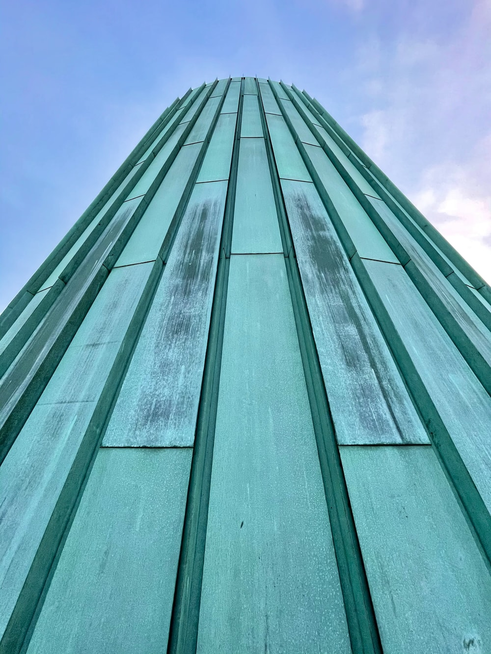 green concrete building under blue sky during daytime