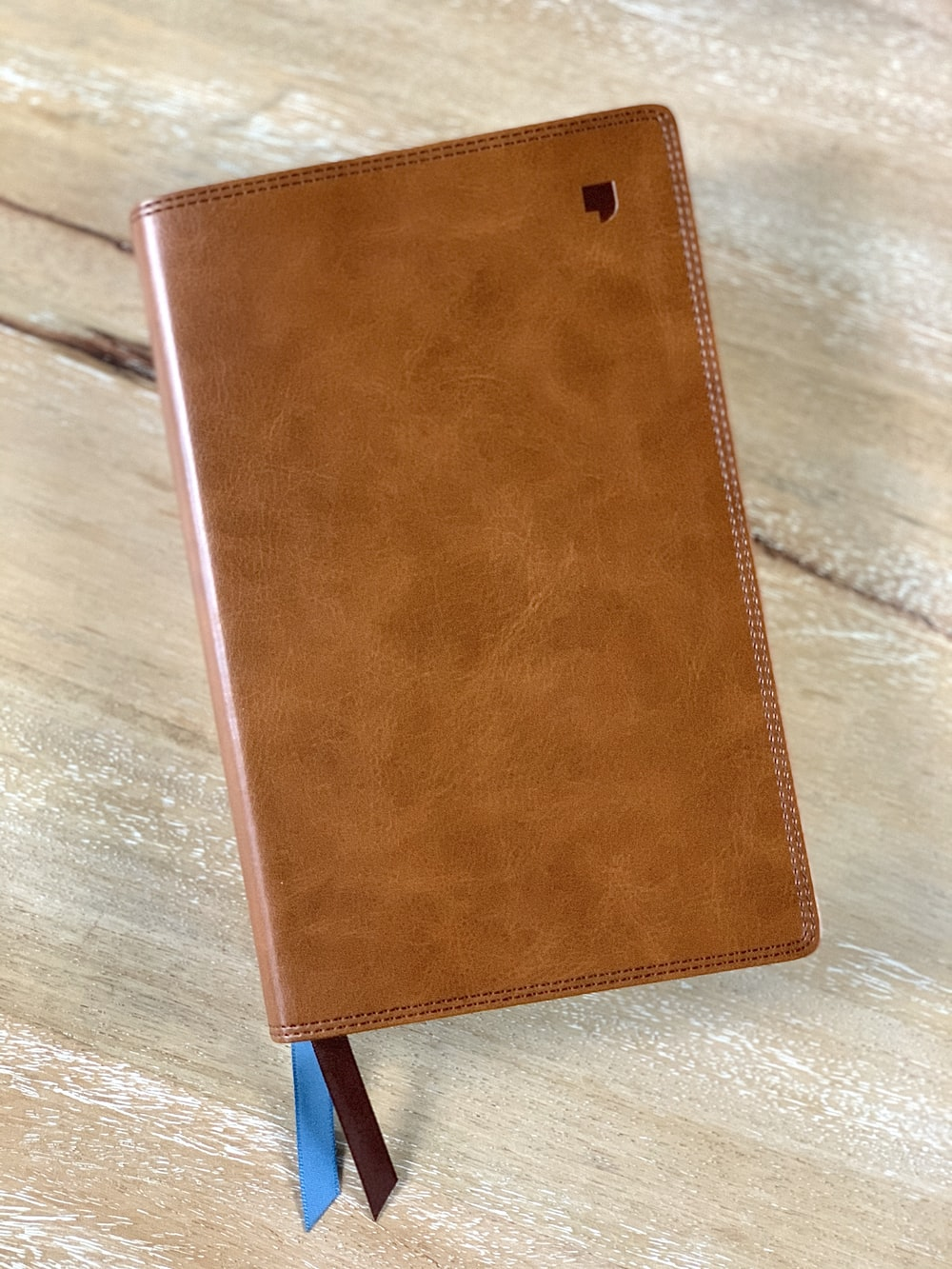 brown leather wallet on brown wooden table