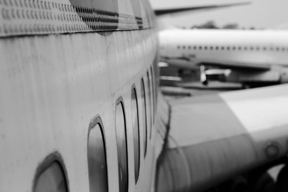 grayscale photo of airplane door