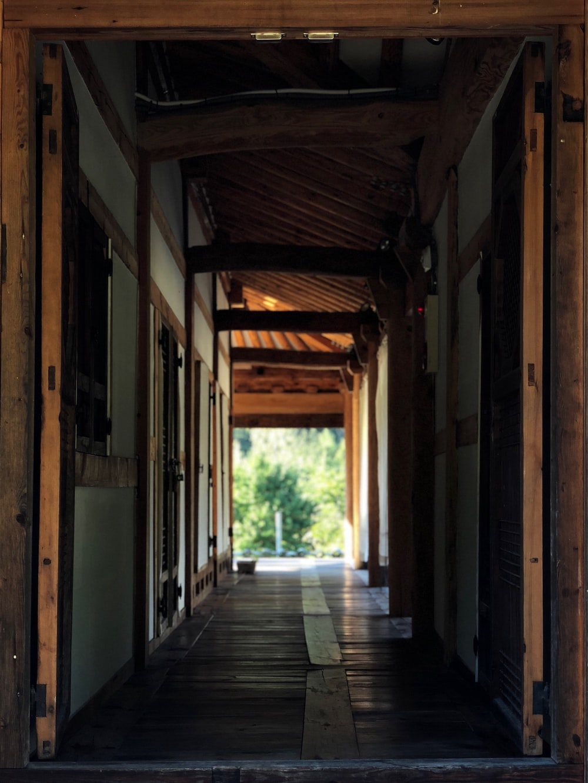 brown wooden hallway during daytime