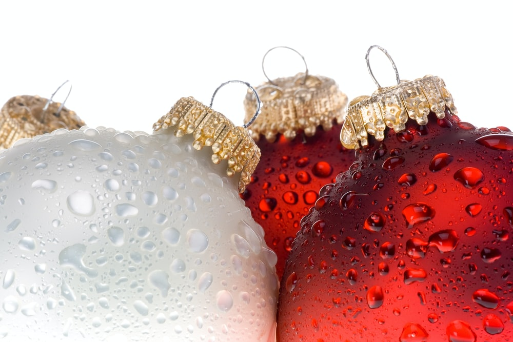 red and gold baubles on white background