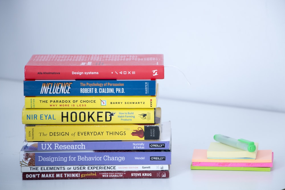 assorted books on white table