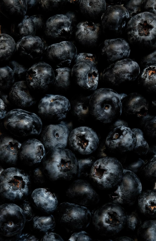 black round fruits on black steel rack