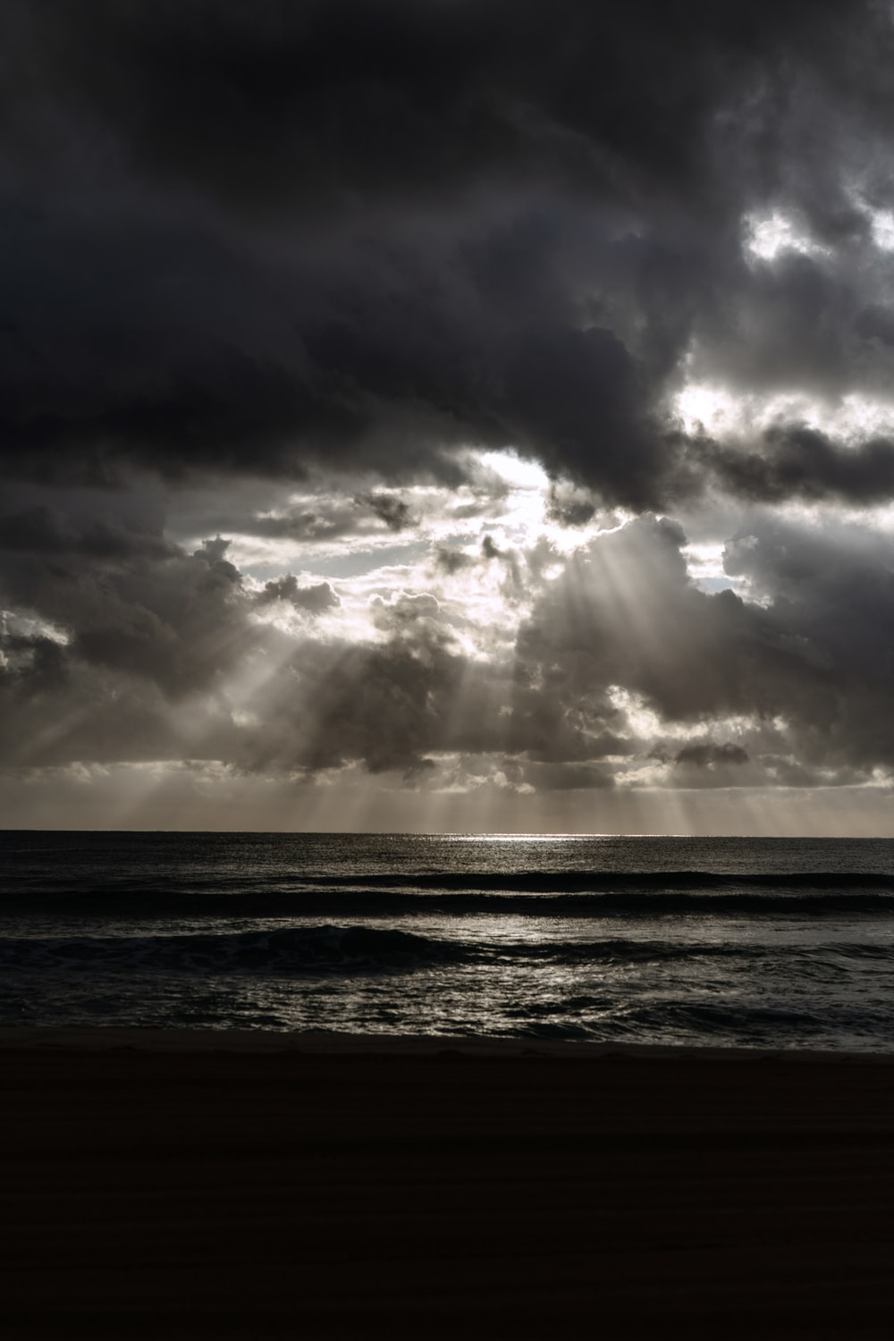 ocean under cloudy sky during daytime