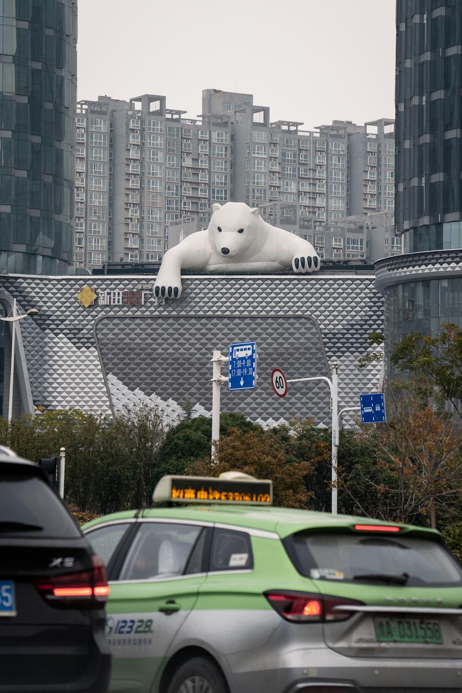 white polar bear on gray metal fence