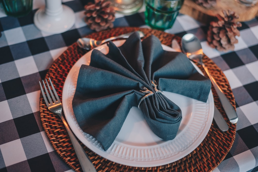 blue and white ribbon on white round plate