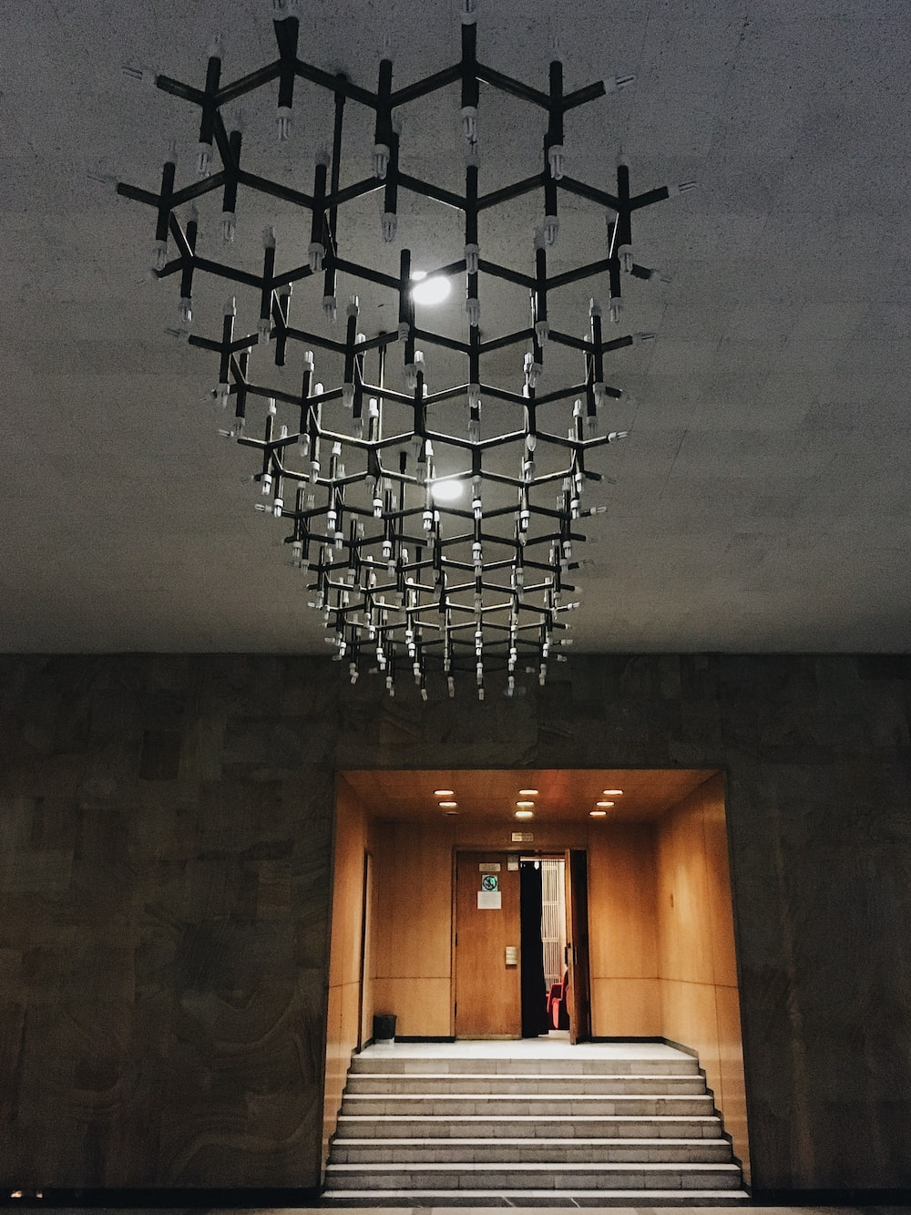 black and white chandelier turned on in room