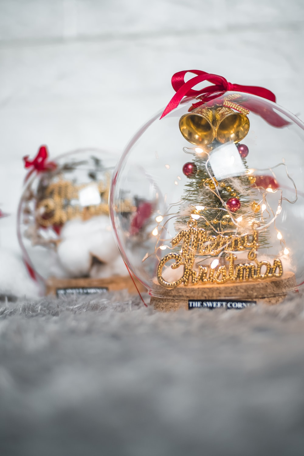 gold and red baubles on snow