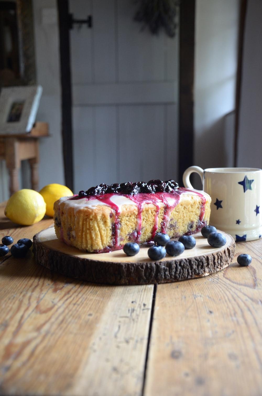 yellow lemon beside white ceramic mug on brown wooden table