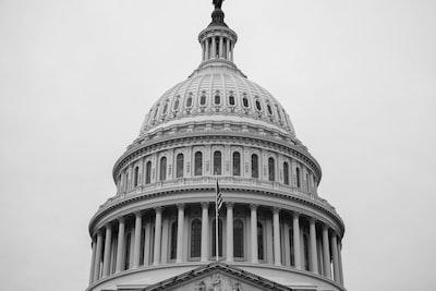 grayscale photo of concrete building republican teams background