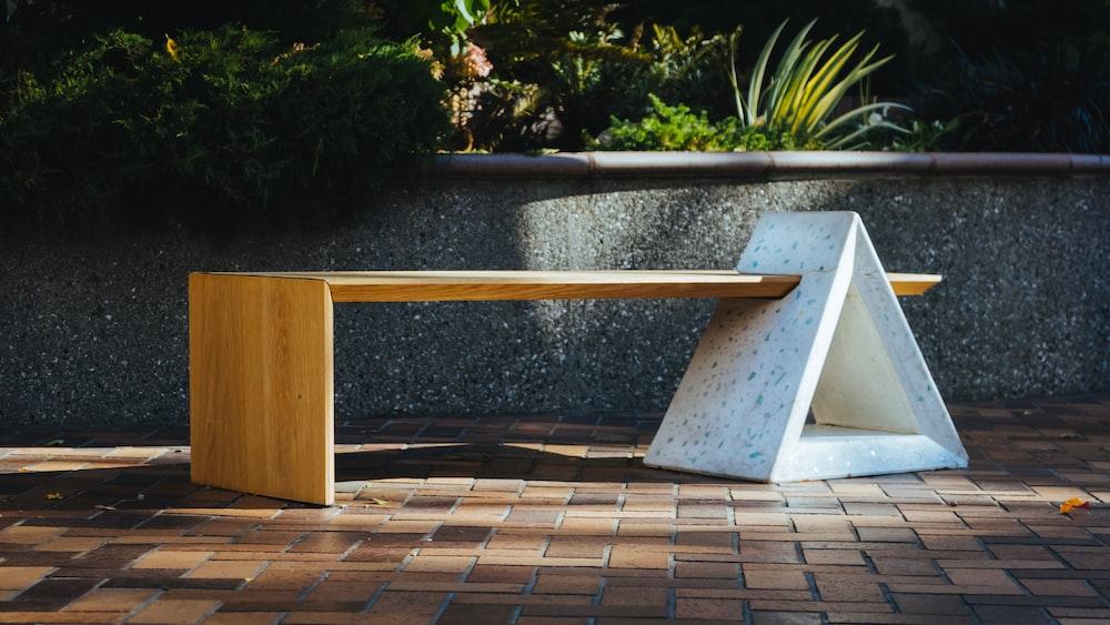 brown wooden table on brown brick floor