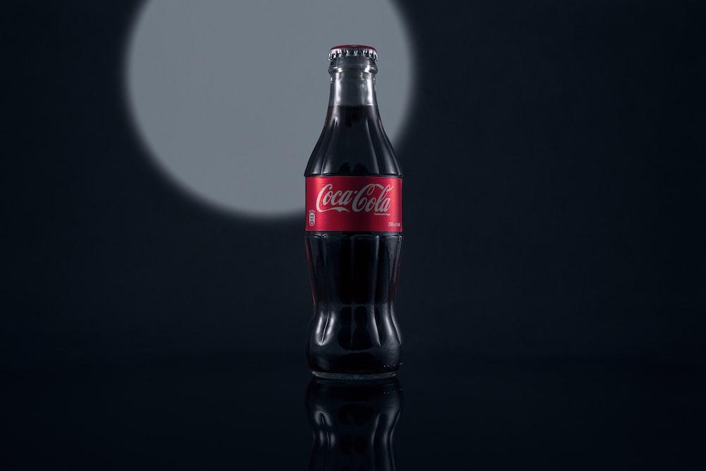 coca cola bottle on black surface