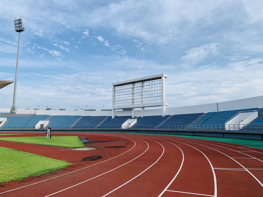 white and blue stadium under blue sky during daytime