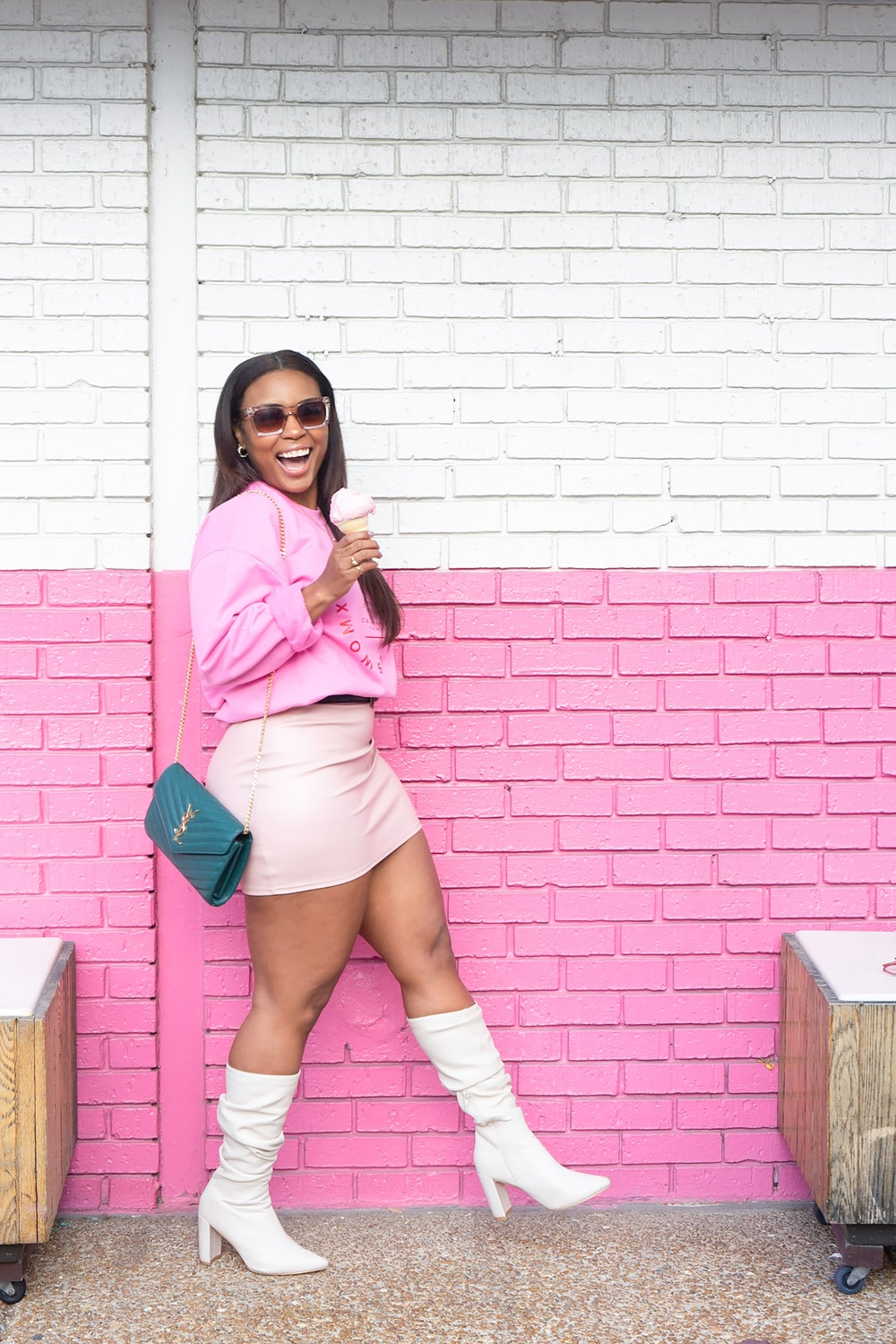 woman in pink long sleeve shirt and white skirt holding blue plastic hair comb
