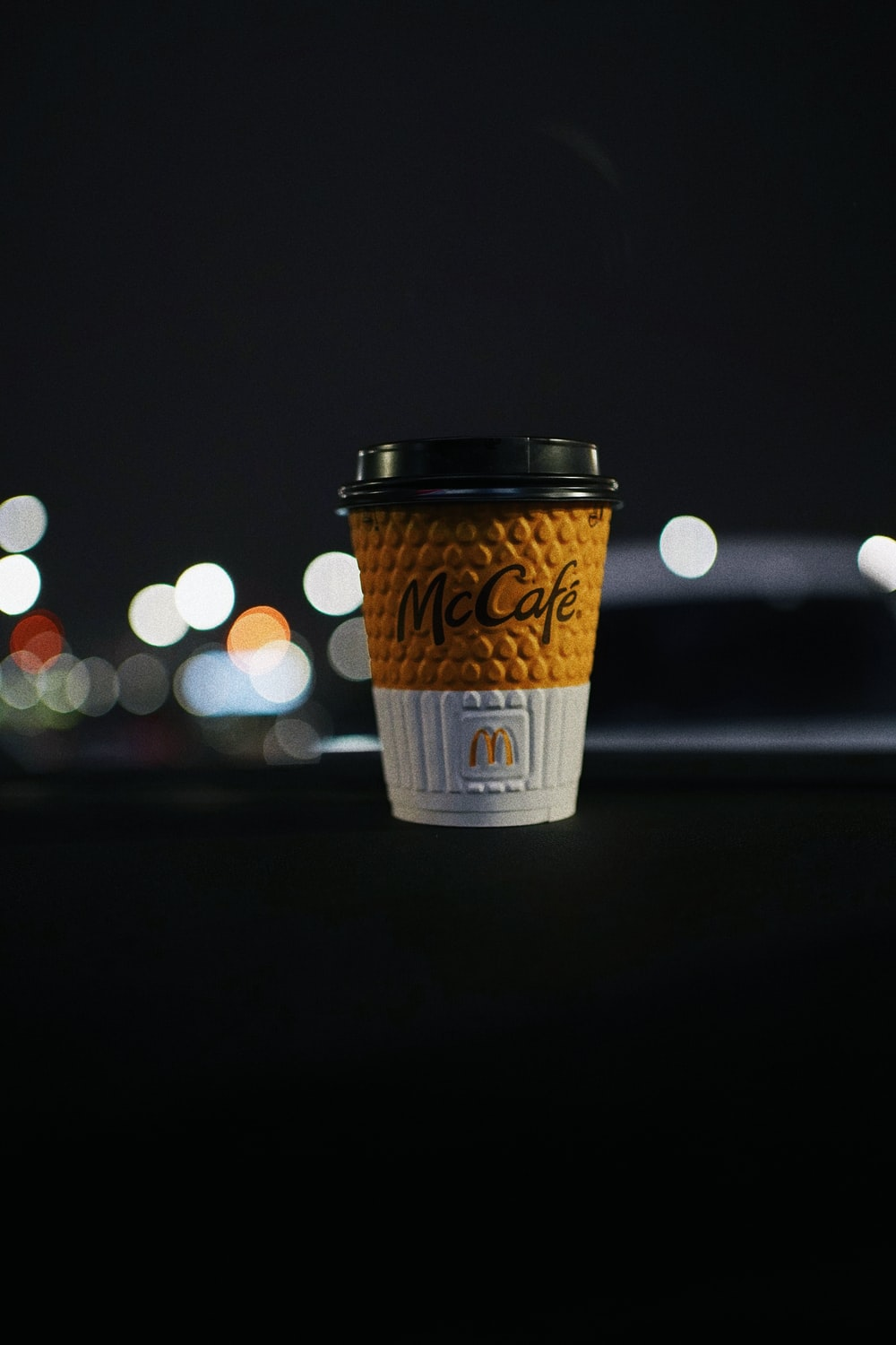 white and brown disposable cup