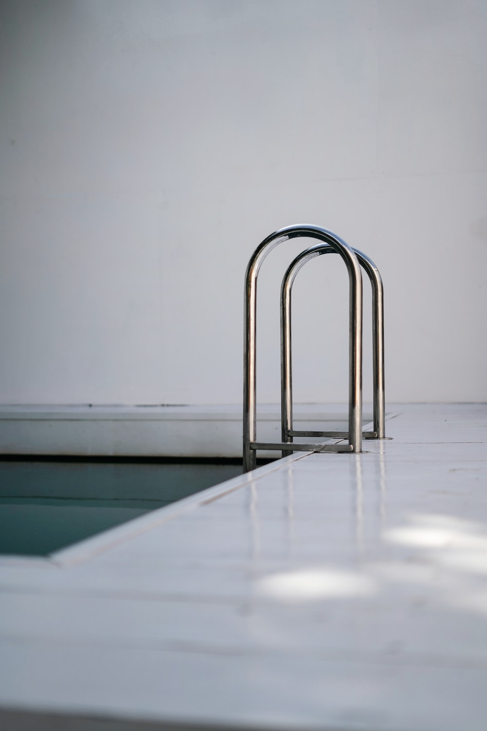 stainless steel rack on white table