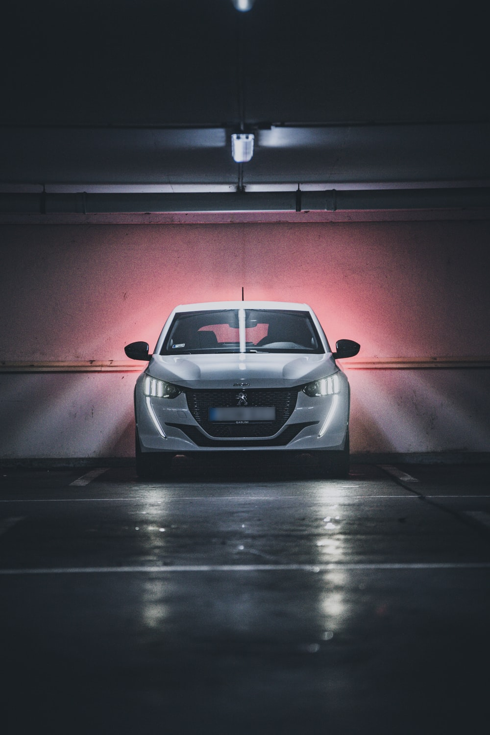 white bmw m 3 coupe in a tunnel