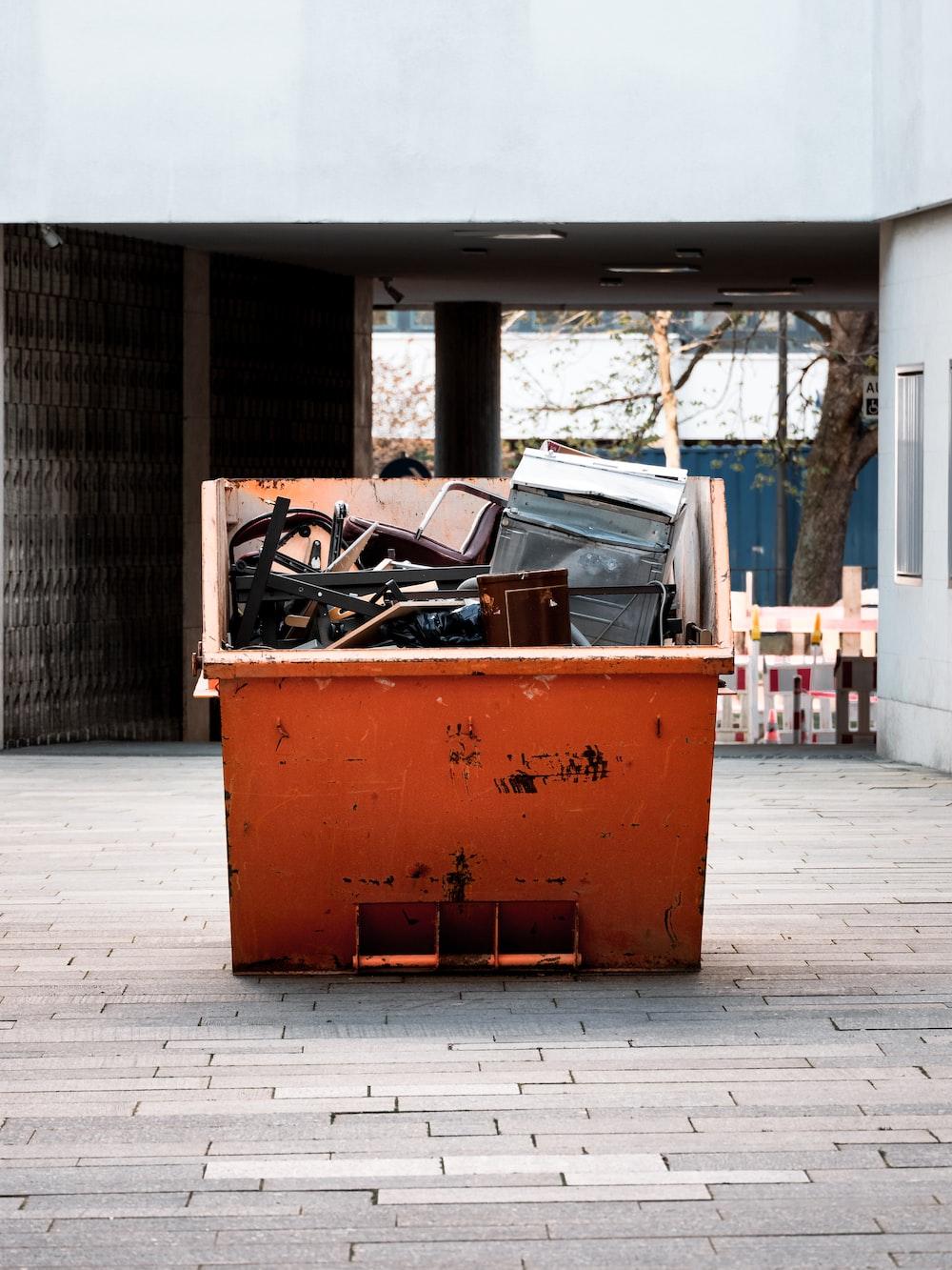 brown cardboard box on gray concrete floor
