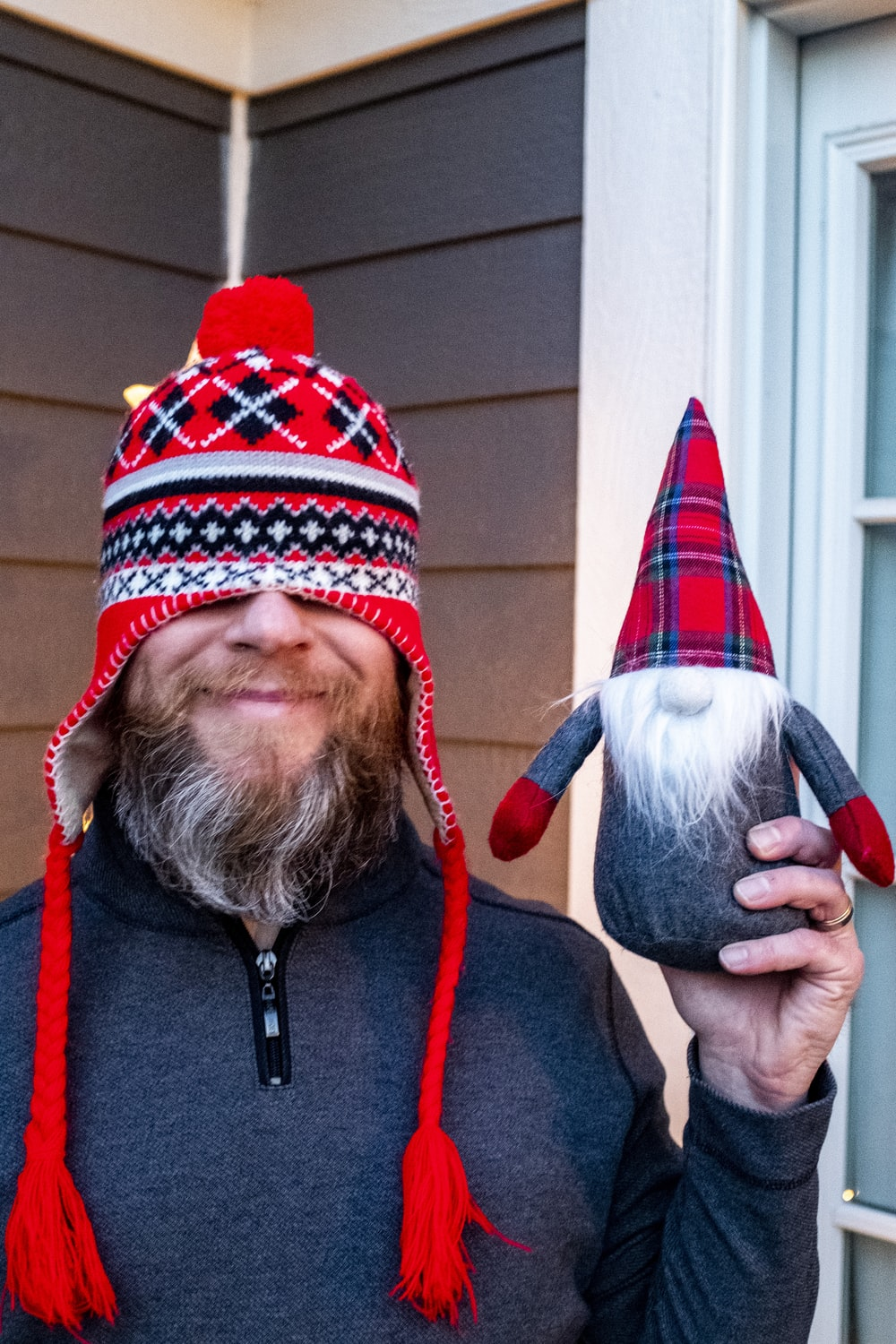 man in red and black knit cap