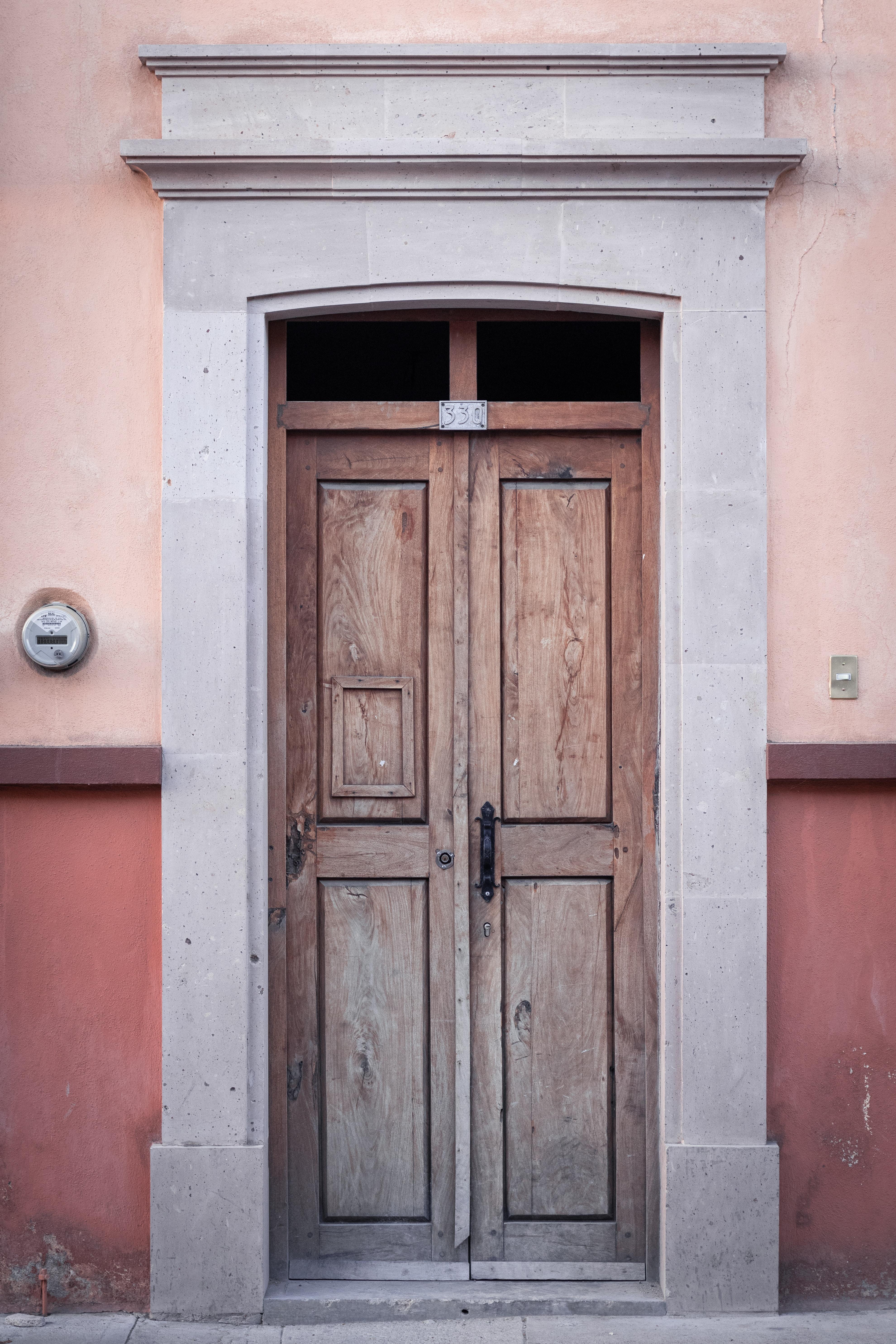 brown wooden door on brown concrete wall