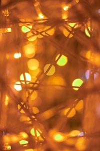 orange light bokeh on brown wooden surface