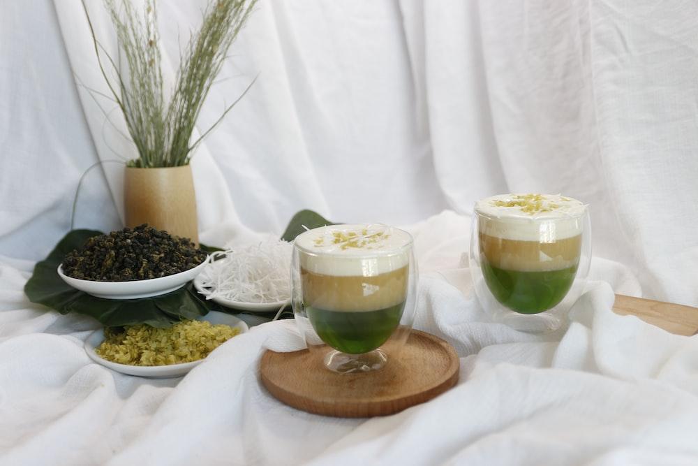 white ceramic bowl with green liquid