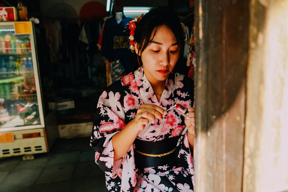 woman in black white and pink floral kimono